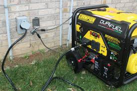 How do you tell the main power is back on when using a portable generator?